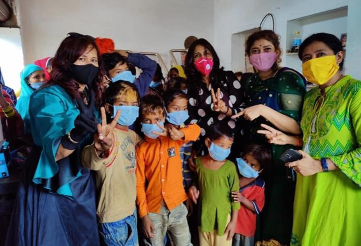 Distribution of mask and clothes at slum Rampura